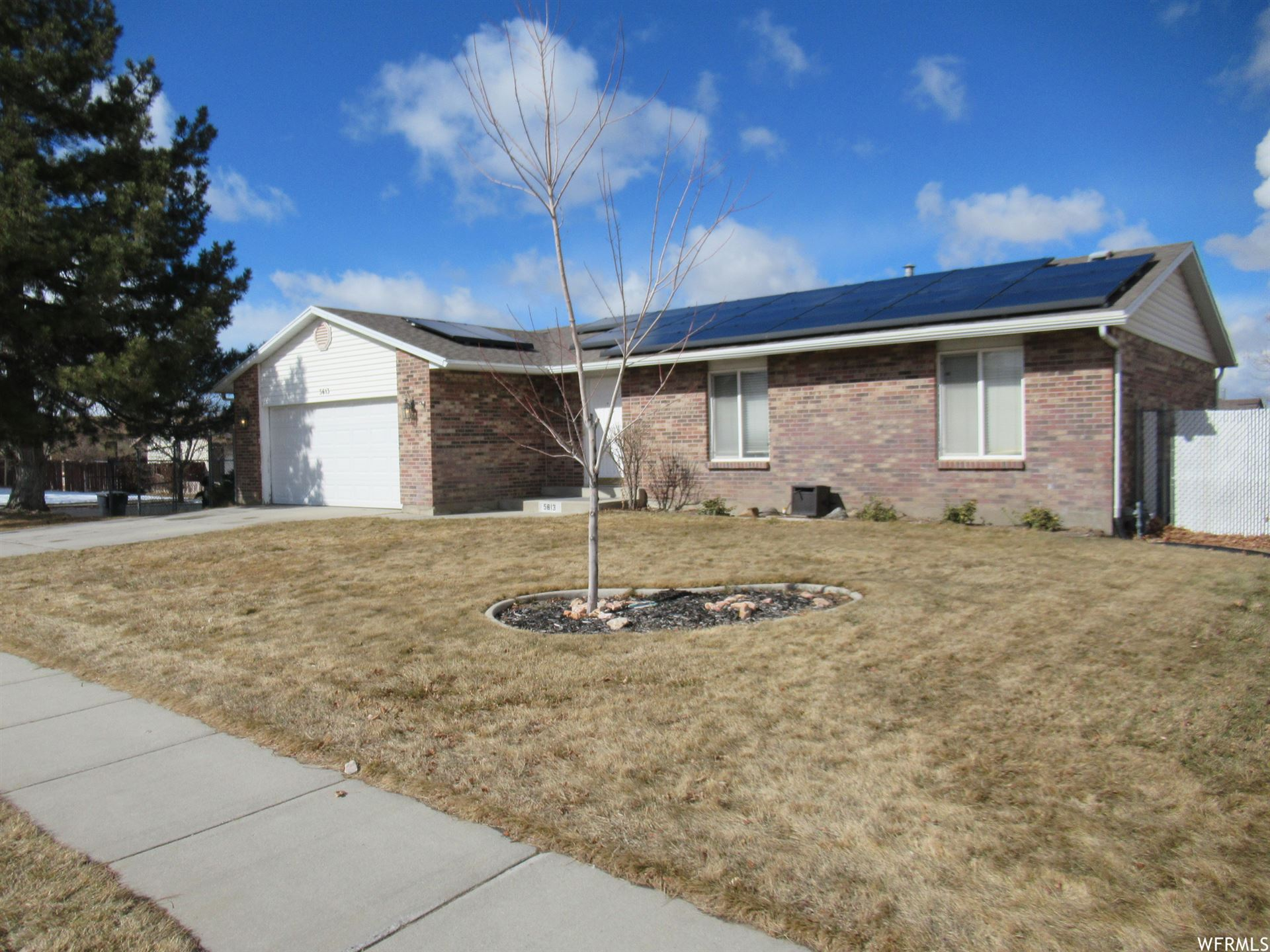 Photo of 5613 S WHITEWOOD DR W DR, Taylorsville, UT 84129 (MLS # 1726378)