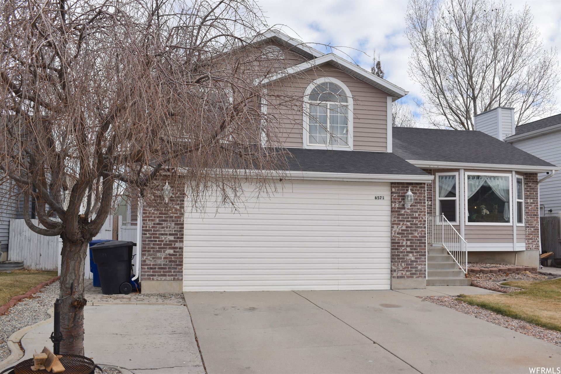 Photo of 6571 S CASTLEFORD DR, Taylorsville, UT 84129 (MLS # 1720426)