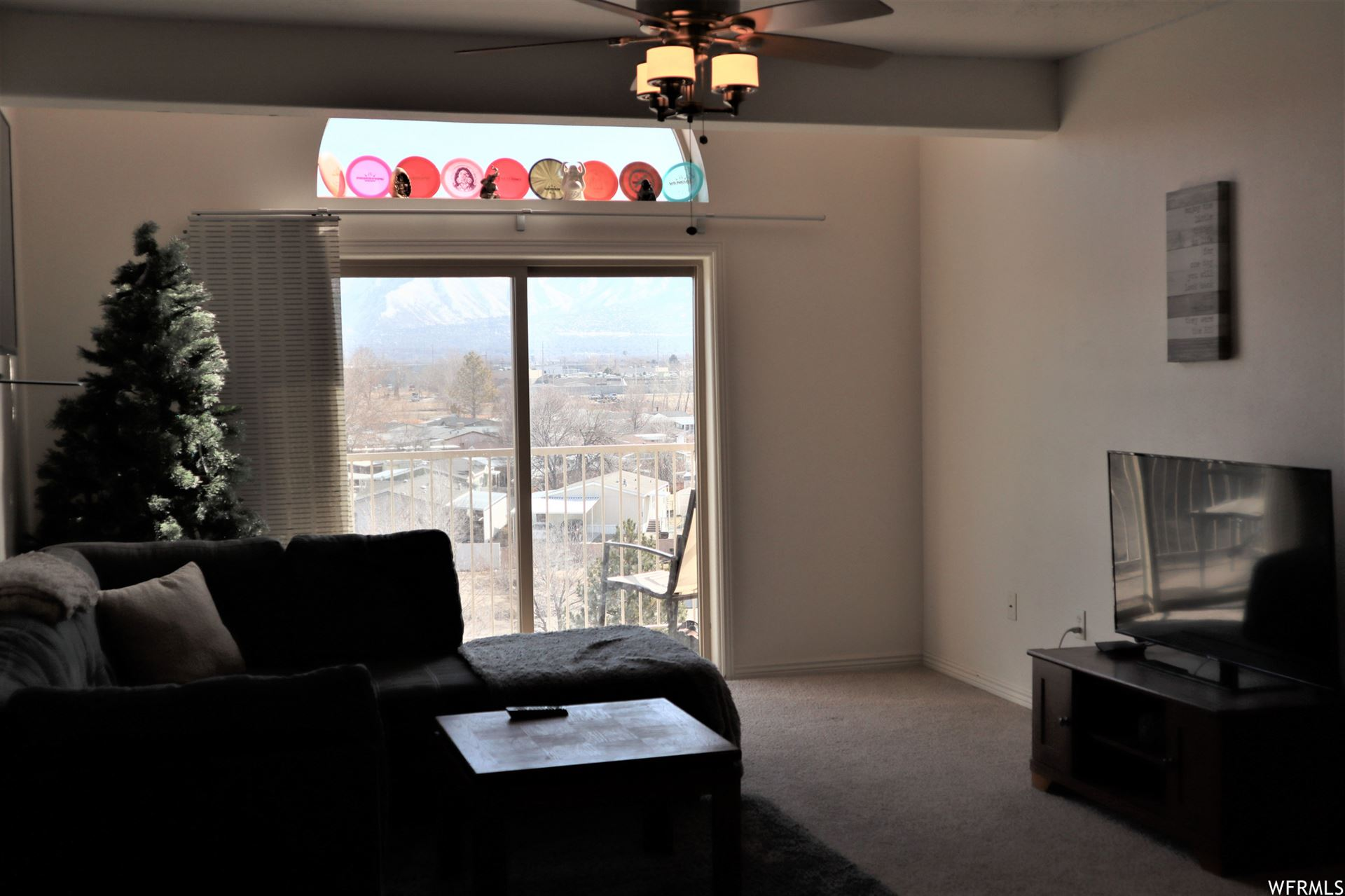 Photo of 3478 S COZY RIVER W PL #401, West Valley City, UT 84119 (MLS # 1727459)
