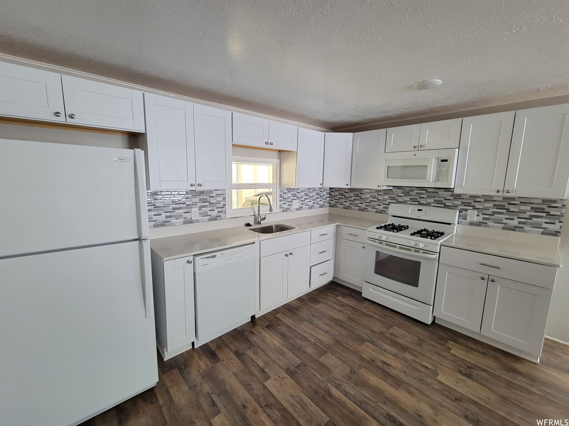 Photo of 4683 S YUCCA DR #319, Taylorsville, UT 84123 (MLS # 1743544)