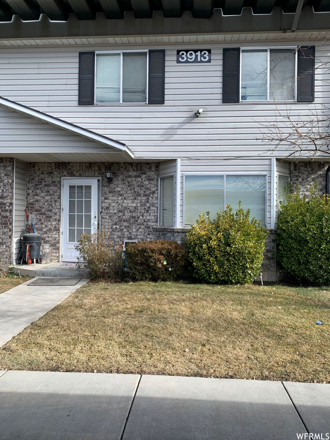 Photo of 3913 W ROCKWOOD WAY #D, West Valley City, UT 84120 (MLS # 1727636)