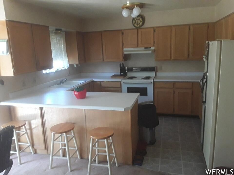 Photo of 5463 W SPIKE S AVE #19, West Valley City, UT 84120 (MLS # 1748639)