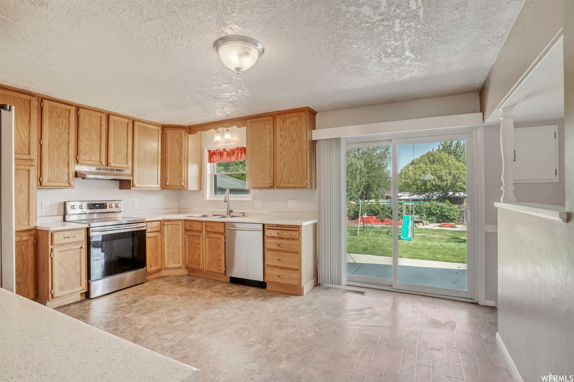 Photo of 1776 W CHAMPAGNE S AVE, Taylorsville, UT 84129 (MLS # 1764682)
