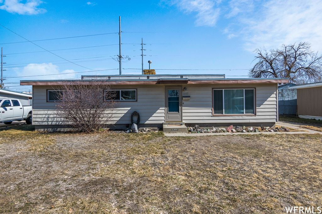 Photo of 3337 S PEARCE W DR, West Valley City, UT 84119 (MLS # 1727692)