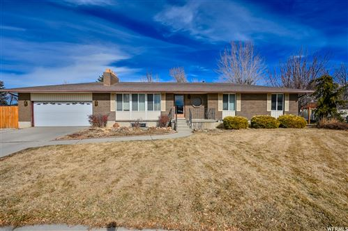Photo of 11234 S TEAKWOOD E CIR, Sandy, UT 84092 (MLS # 1727744)