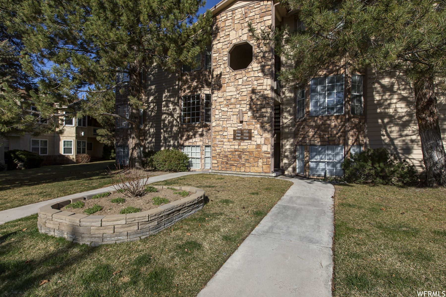 Photo of 7711 S BRIARSPRINGS DR, Midvale, UT 84047 (MLS # 1732765)