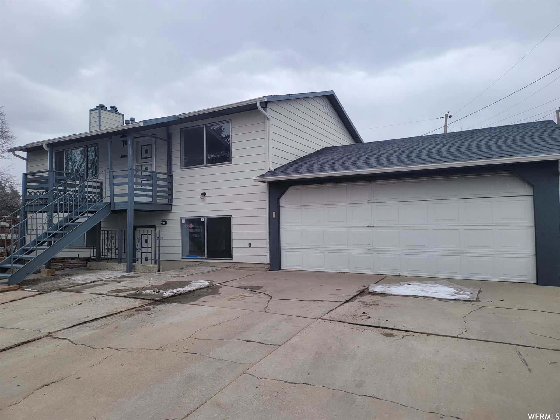Photo of 5699 W DARLE AVE, West Valley City, UT 84128 (MLS # 1726771)