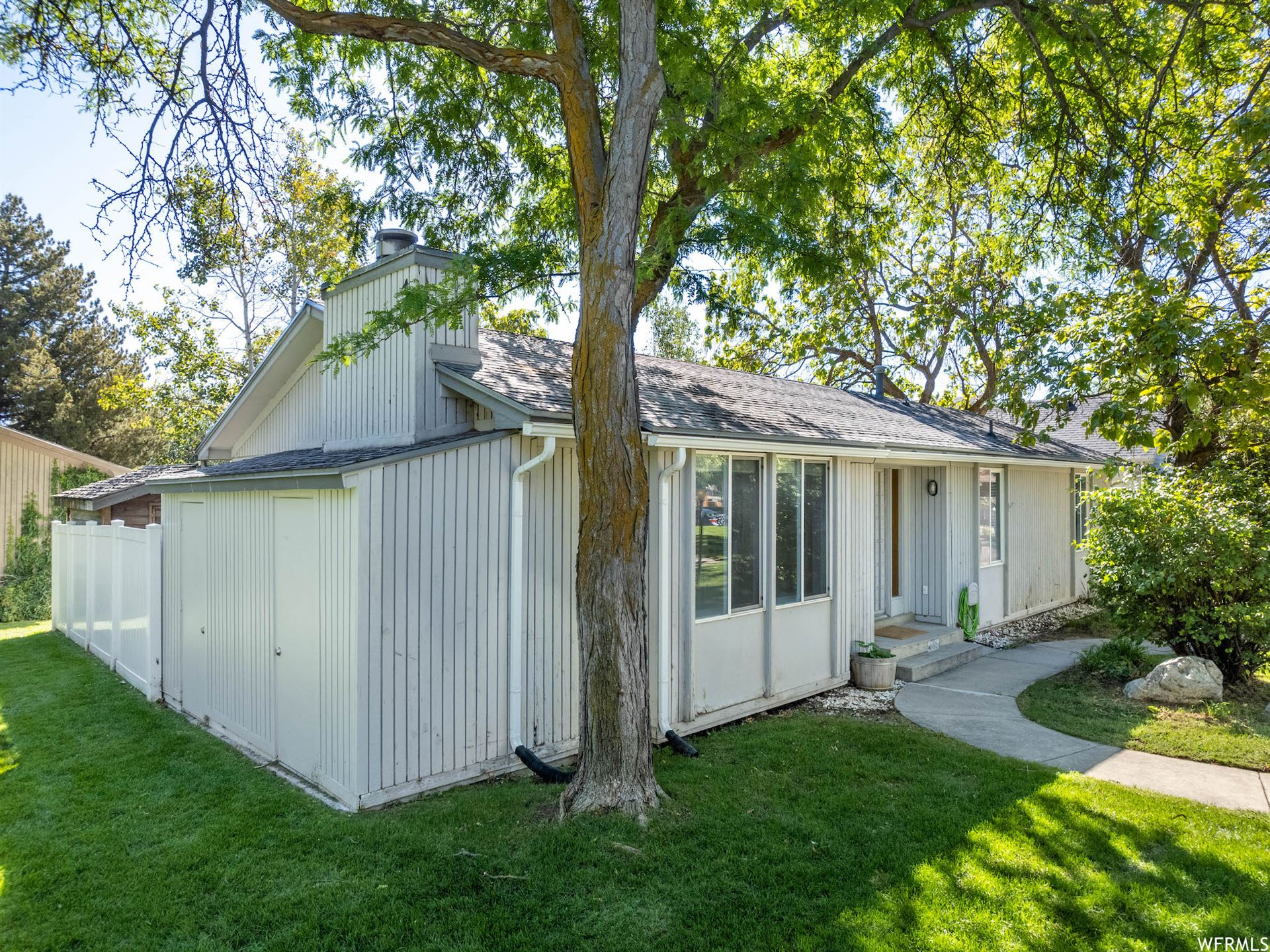 Photo of 3158 W WESTCOVE DR, West Valley City, UT 84119 (MLS # 1770823)