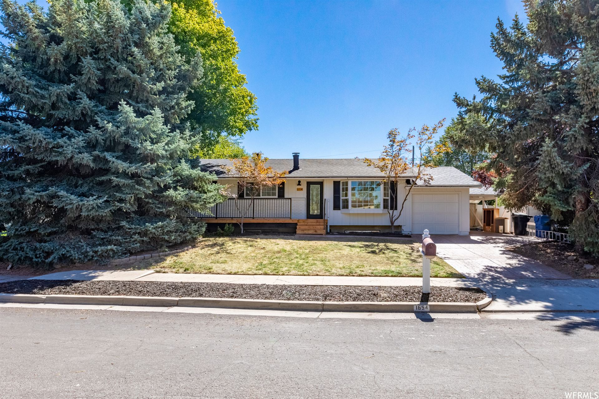 Photo of 1654 DAWN E DR, Cottonwood Heights, UT 84121 (MLS # 1770828)