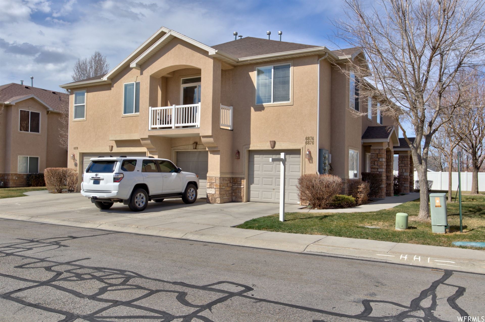 Photo of 6876 W BAMBURGH S WAY, West Valley City, UT 84128 (MLS # 1731886)