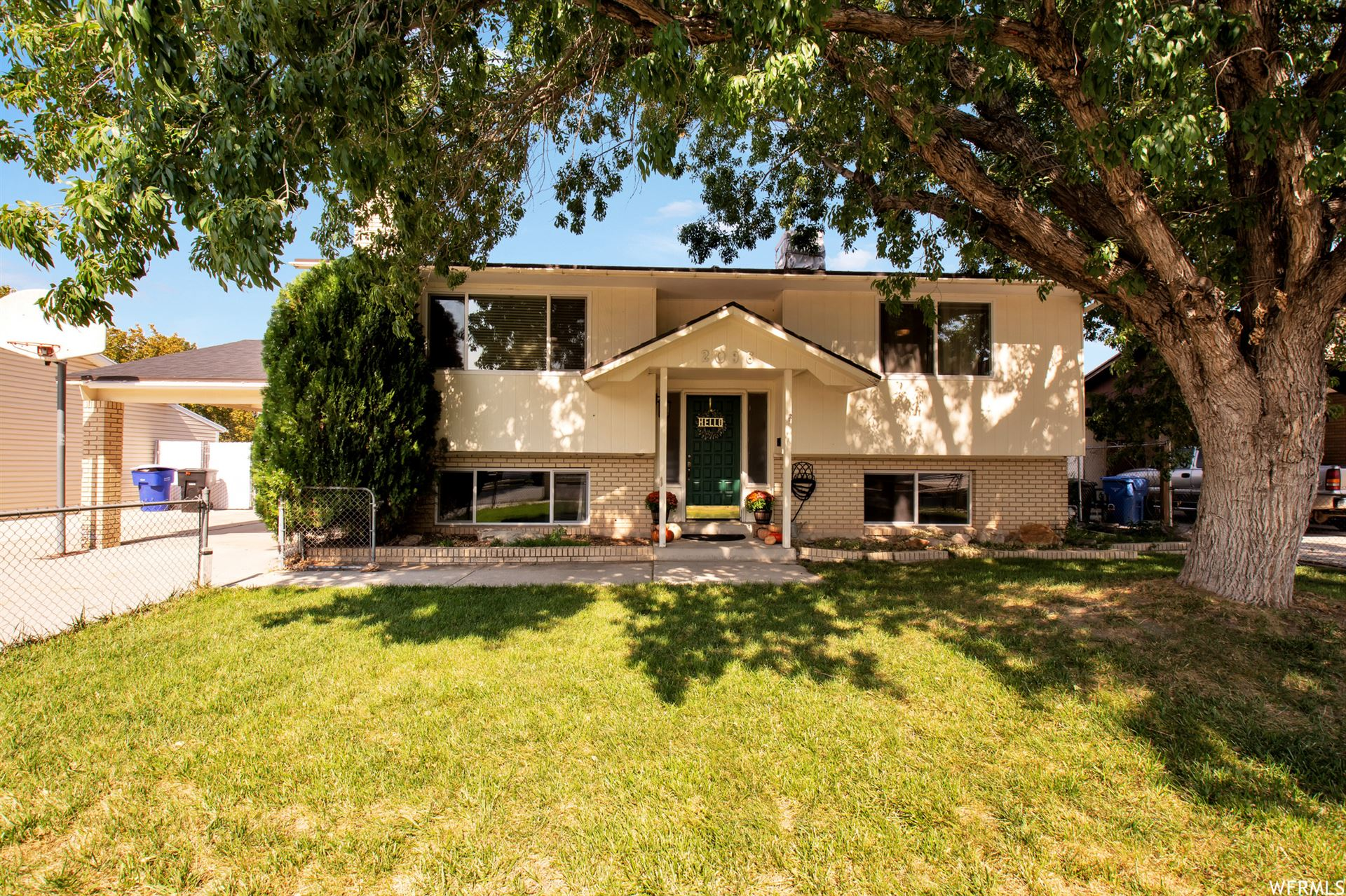 Photo of 2096 W HAPPINESS DR, Taylorsville, UT 84129 (MLS # 1770919)