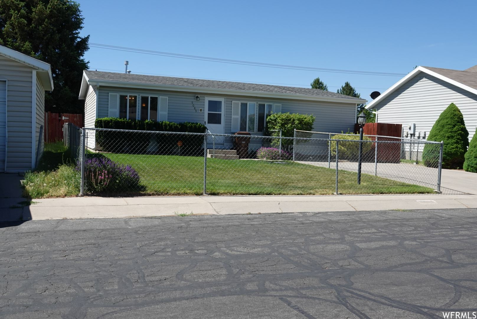 Photo of 5089 W FESTIVAL DR, West Valley City, UT 84120 (MLS # 1748958)