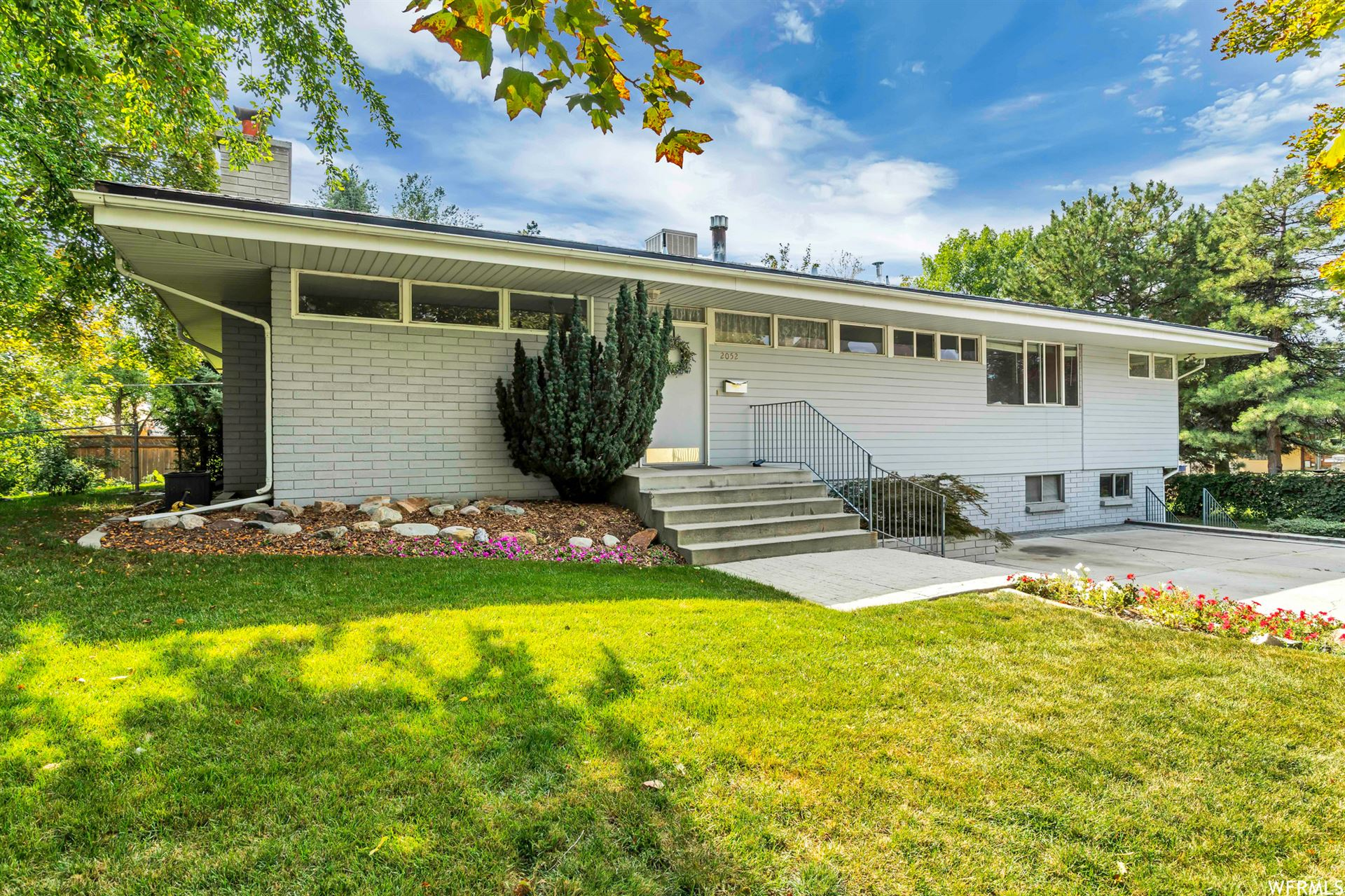 Photo of 2052 E SYCAMORE LN, Holladay, UT 84117 (MLS # 1770995)