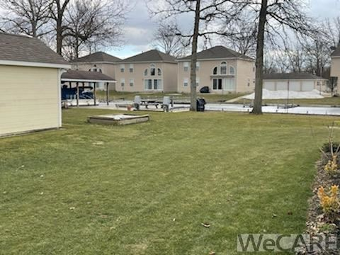 Photo of 10410 Buckeye Road, Huntsville, OH 43324 (MLS # 204035)