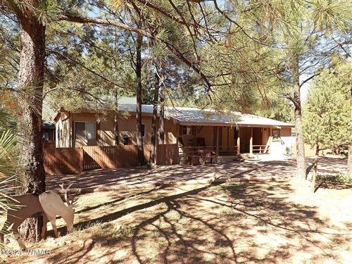 Photo of 2048 Wilderness Drive, Overgaard, AZ 85933 (MLS # 238024)