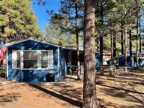 Photo of 2853 Whispering Winds Drive, Overgaard, AZ 85933 (MLS # 234274)