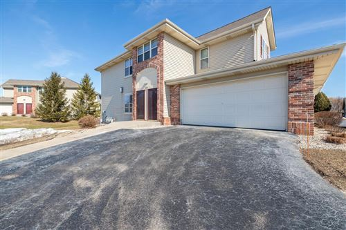 Photo of 1022 E Woodview Ct #1, Slinger, WI 53086 (MLS # 1696161)