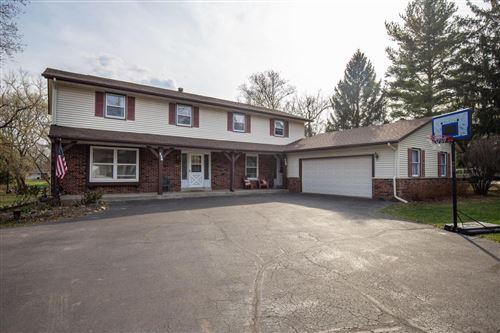 Photo of 138 Huntington Rd #140, Delafield, WI 53018 (MLS # 1734219)