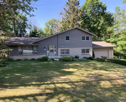 Photo of N77W22240 Wooded Hills Dr, Lisbon, WI 53089 (MLS # 1749526)