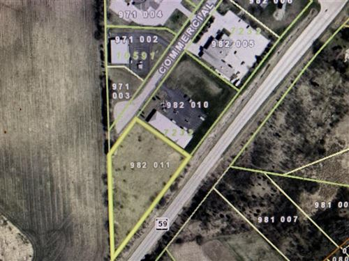 Photo of W309S4875 Commercial Dr, North Prairie, WI 53153 (MLS # 1741628)
