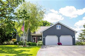 Photo of 405 N Fairfield Ave, Juneau, WI 53039 (MLS # 1860724)