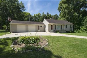 Photo of 7911 W Barnard Ave, Greenfield, WI 53220 (MLS # 1648791)
