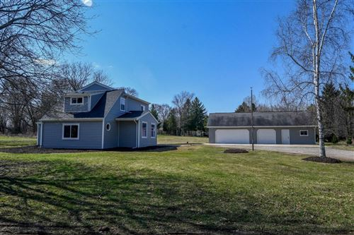 Photo of 141 S Cushing Park Rd, Delafield, WI 53018 (MLS # 1732857)