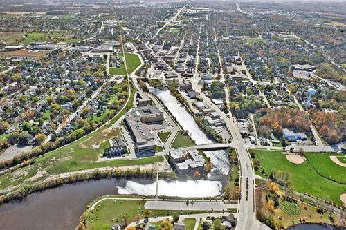 Photo of 705 Village Green Way #301, West Bend, WI 53090 (MLS # 1694887)