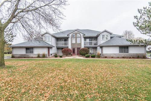 Photo of 711 Quinlan Dr #F, Pewaukee, WI 53072 (MLS # 1715929)