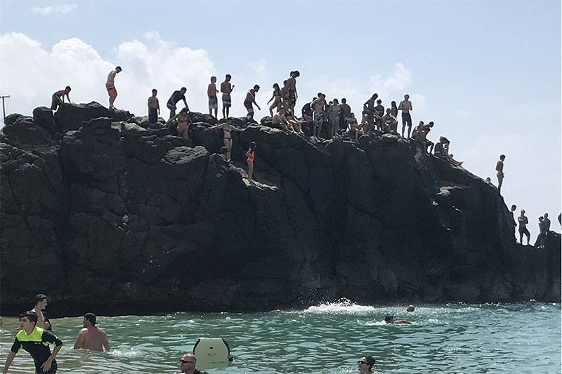 jumping off the rock at waiamea