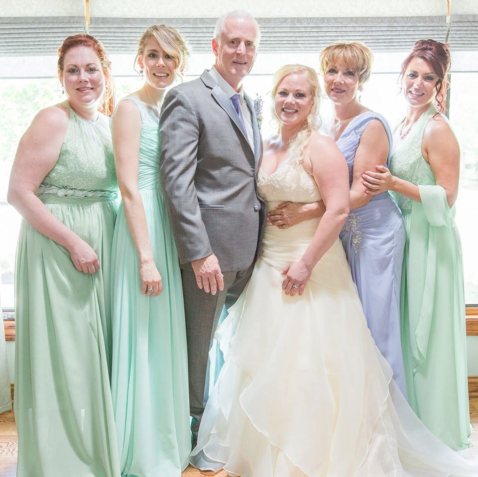 laura and Paul wedding photo with all the girls