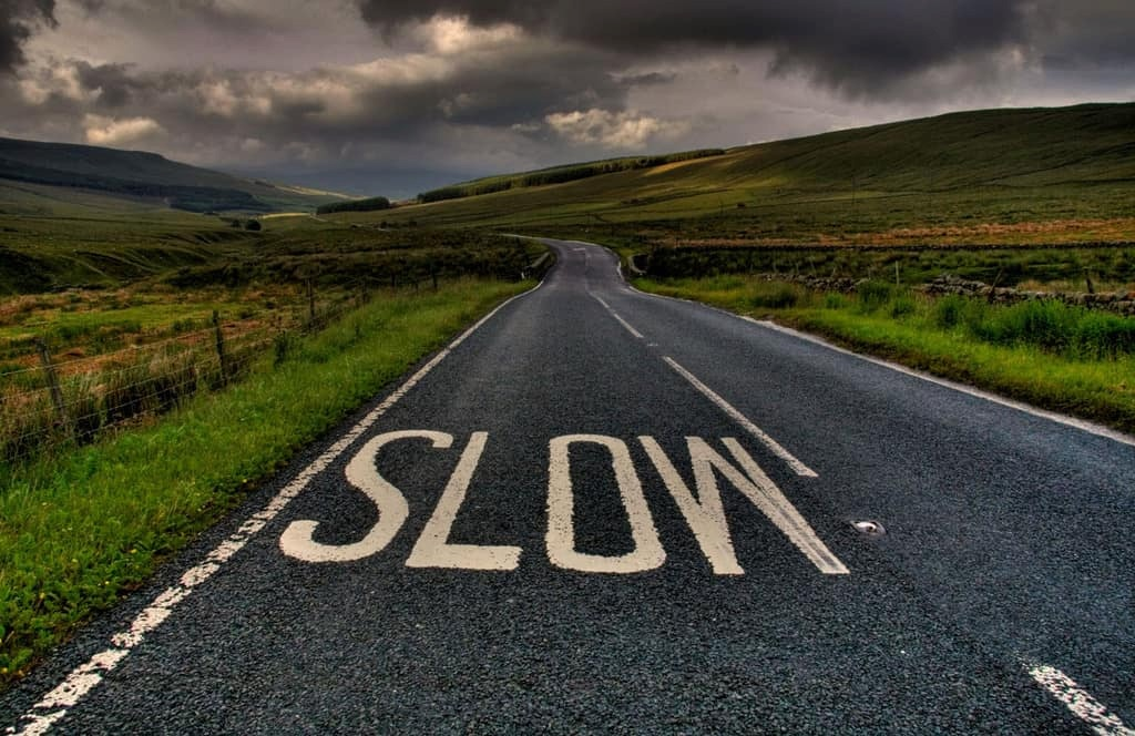 Road-in-Country-with-Slow-Sign