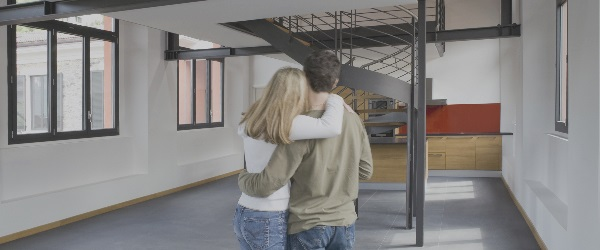 Couple looking at home interior